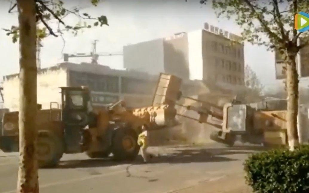 Real-Life Transformers: Bulldozers Battle On Streets Of China!