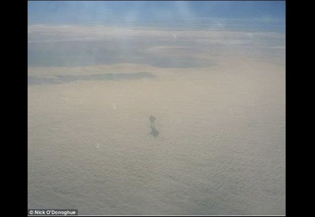 Giant Walking On Clouds? Mysterious Photo Taken From 30,000 Feet