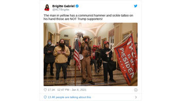 Fact Check: Man Pictured Inside Capitol Does NOT Have A Hammer And Sickle Tattoo On His Hand