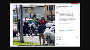 Fact Check: San Diego Police Say Photo Does NOT Show Officer Pointing His Gun At A Boy, But Videos Suggest A More Nuanced Reality