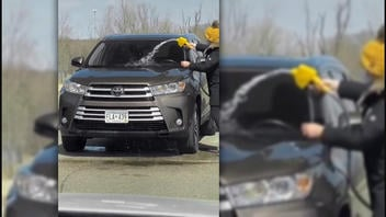 Fact Check: Woman In Video Did NOT Really Wash Her Car With Gasoline -- It's A Skit