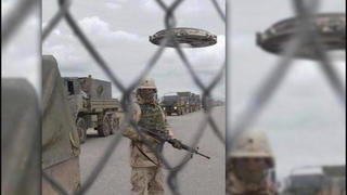Fact Check: Picture Of Military Convoy Did NOT Originally Include UFO -- It's A Photoshop Contest