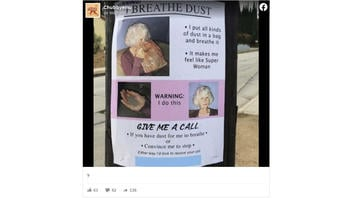 Fact Check: This Poster Of A Woman Advertising Her Love Of Breathing Dust Is NOT Real -- It's Art