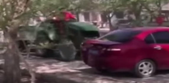 Video: Chinese Farmer Destroys Illegally Parked Cars