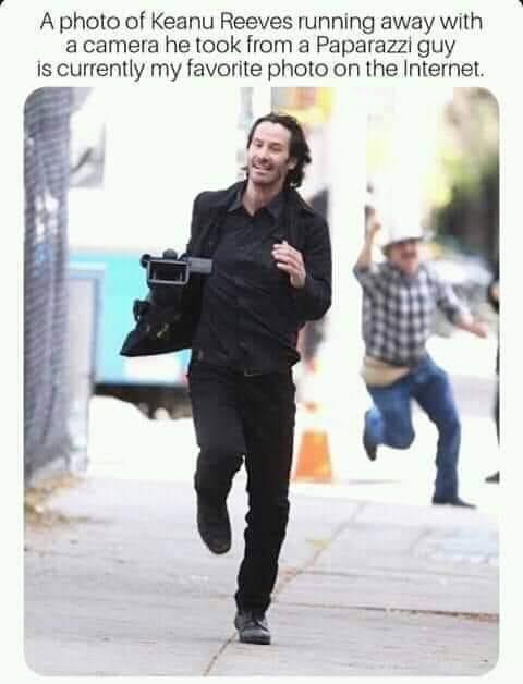 Fake News: NOT A Picture Of Keanu Reeves Running Away With Camera From Paparazzi